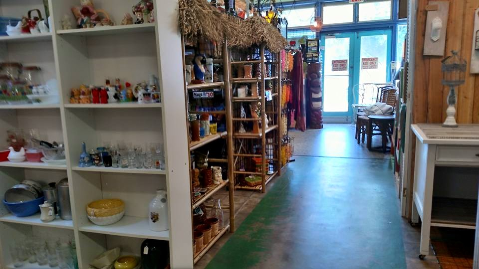 Towards the door, there are shelves filled with vintage finds!