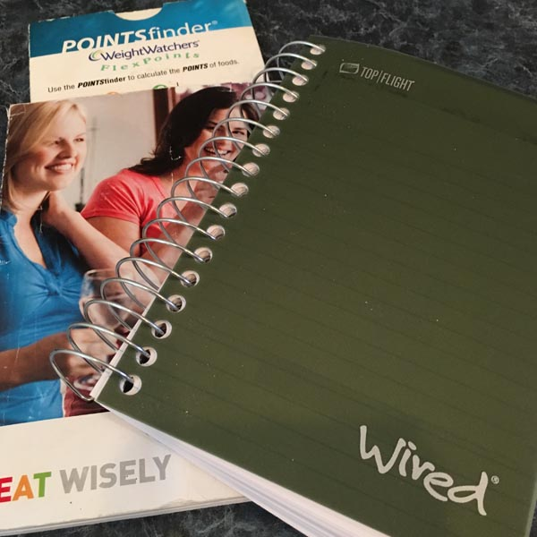 Weight Watchers book and spiral notebook