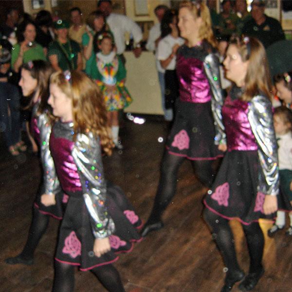 Irish step-dancers entertain in a pub.