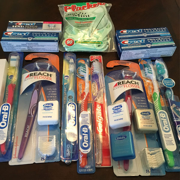 New toothbrushes and toothpaste ready to donate