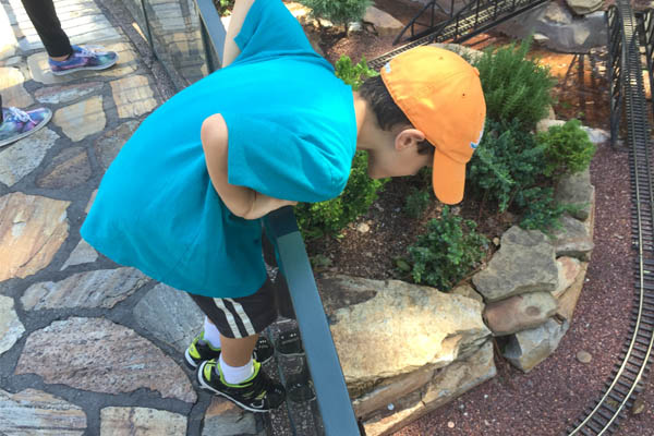 Checking out the model train set at Epcot.