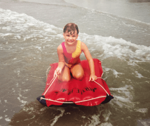 Girl on a raft on the beach in South Carolina in the 1990s
