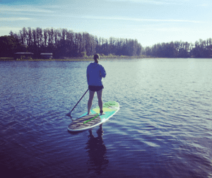Woman on a paddleboarding me-time escape on a lake in Lutz, Florida