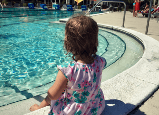 Confident toddler swimmer trained in survival swimming