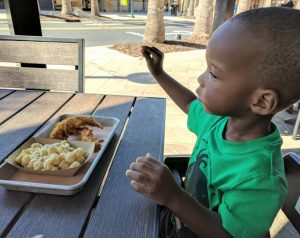 Kids eat free in tampa bay - toddler eating a meal