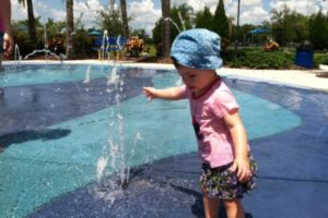 Little Girl Plays at Splash Pad in Lakewood Ranch, Florida