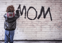 child spraypainting mom