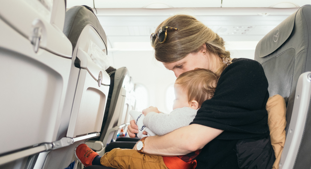 mom and baby on airplane sitting