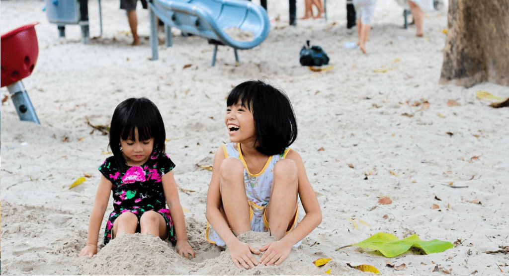 Two kids at a beach playground
