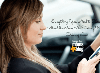 beautiful woman texting while driving