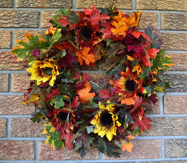 fall floral wreath on brick wall
