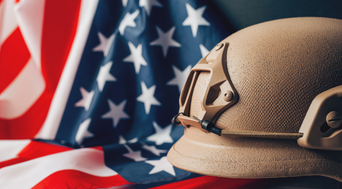 american flag and army helmet