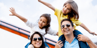 kids flying with arms on top of mom and dad