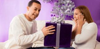 man giving woman gift for christmas
