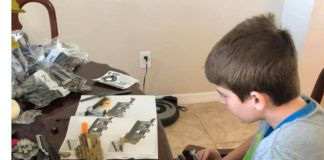 tween sitting building legos