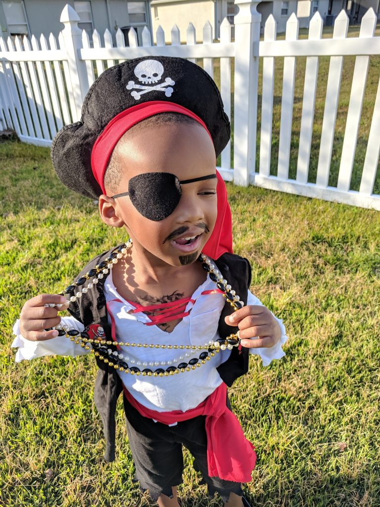 Young black boy dressed as a pirate