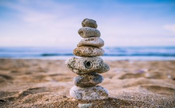 beach setting with rocks stacked to represent mindset resolutions