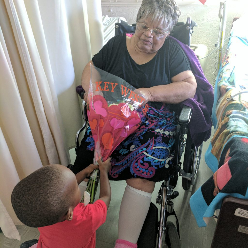 toddler and elderly woman in nursing home