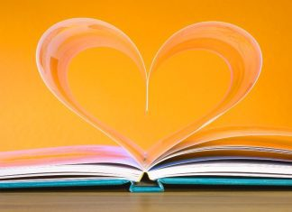 open book with heart in the middle