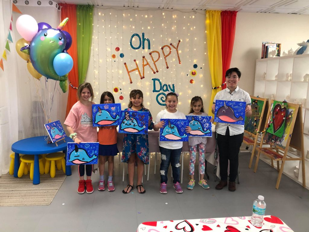 Happy Hearts Art Studio - Kids with final art projects