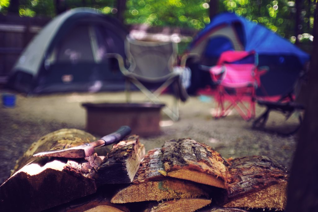 camping outdoors with firewood