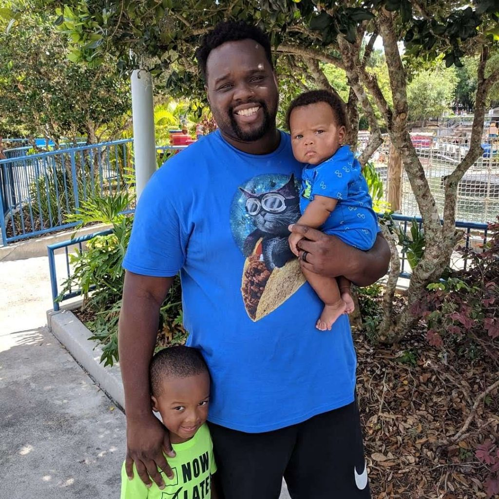 African-American father with sons