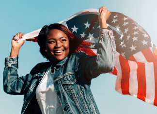 black-smiling-female-raising-hands-with-usa-flag