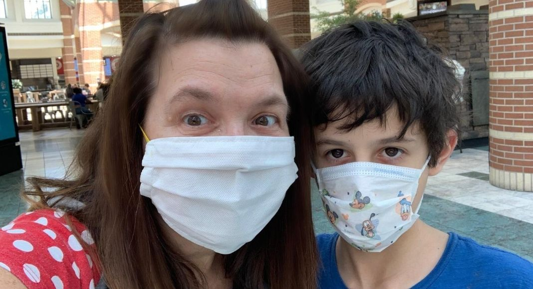 Mom and son with face coverings